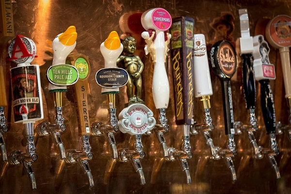 Goose Island beer taps are seen amongst other craft beers at a bar in New York